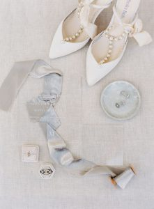 Wedding flat lay with bride shoes, bride jewels and